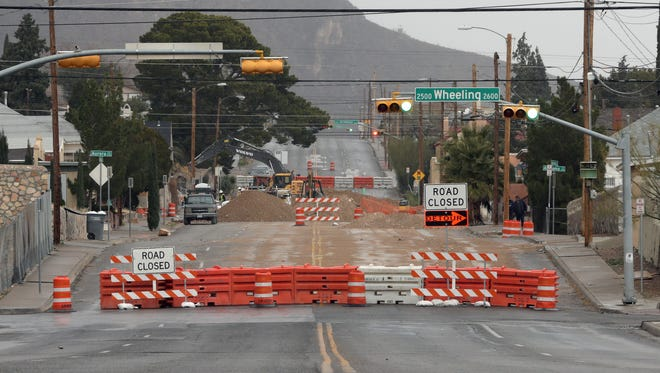 Alabama Street is closed at Wheeling Avenue in Central El Paso as workers complete a new stormwater retention pond. El Paso water, sewer, and stormwater rates are rising again this year to help pay for similar new projects and other rising costs, El Paso Water officials say.