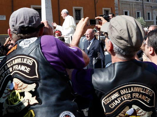 Pope Francis blesses the Harley-Davidson bikers from his Popemobile in Rome