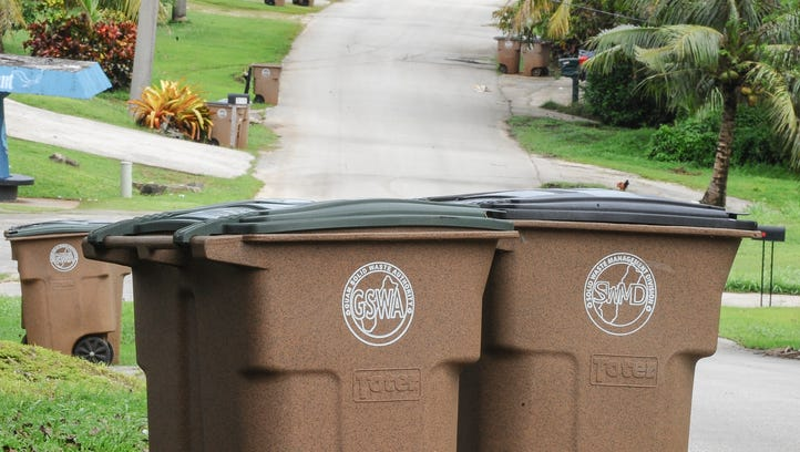 In this file photo trash receptacles line both sides