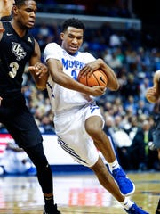 Memphis guard Jeremiah Martin drives the lane against