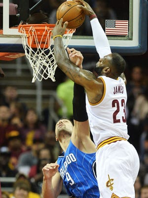 Cleveland Cavaliers forward LeBron James (23) dunks the ball over Orlando Magic center Nikola Vucevic (9) during the first quarter at Quicken Loans Arena.