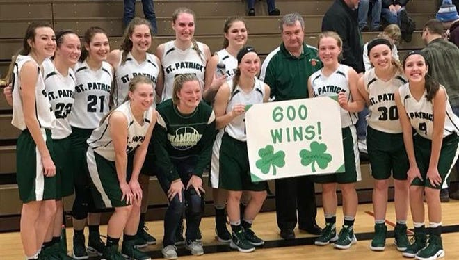 Portland St. Patrick players pose for a picture with coach Al Schrauben after he picked up his 600th career coaching victory Tuesday.