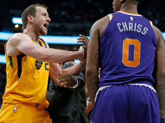Utah Jazz forward Joe Ingles (2) goes after Phoenix Suns forward Marquese Chriss (0) after Jazz guard Ricky Rubio was shoved to the court during the second half of an NBA basketball game Thursday, March 15, 2018, in Salt Lake City. Suns' Jared Dudley and Chriss were ejected. (AP Photo/Rick Bowmer)
