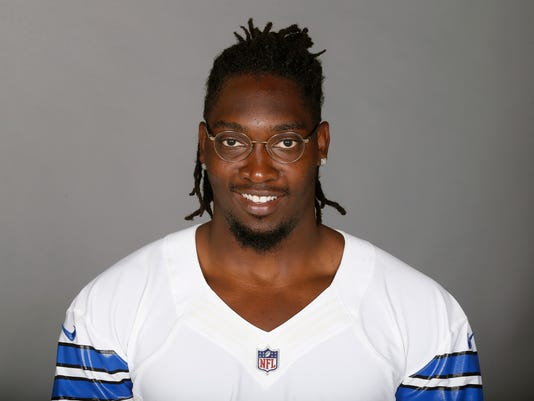 FILE - This June 5, 2017 file photo shows DeMarcus Lawrence of the Dallas Cowboys NFL football team. A person with knowledge of the decision says the Cowboys have placed the franchise tag on Lawrence, guaranteeing the Pro Bowl defensive end $17.5 million in 2018. The Cowboys had until Tuesday, March 6, 2018 to put the tag on Lawrence. The 25-year-old can still sign a long-term deal with the club that traded up him to get him early in the second round in 2014. Lawrence tied Jacksonville's Calais Campbell for second in the NFL with 14 1/2 sacks last season. (AP Photo, file)