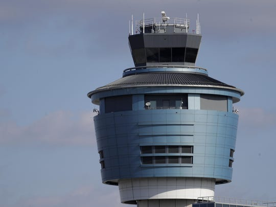 "The air traffic control tower at LaGuardia Airport is seen, Friday, Jan. 25, 2019, in New York. New York Gov. Andrew Cuomo says delays at East Coast airports amid a partial federal government shutdown are another symptom of the ""federal madness"" caused by Republican President Donald Trump. Earlier Friday, the FAA announced LaGuardia Airport and Newark Liberty International Airport in New Jersey were both experiencing delays in takeoffs due to staffing problems at two air traffic control facilities. (AP Photo/Julio Cortez)"
