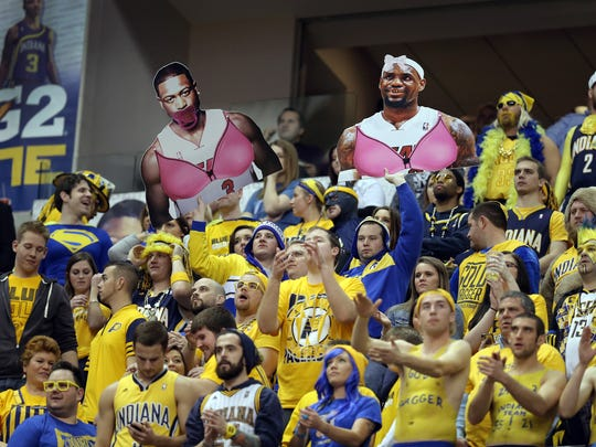 Pacer fans in the G2 Zone hold up their own Dwyane Wade and LeBron James  cut-outs in the second half of their game. Indiana Pacers defeated the Miami Heat 90-84Tuesday, December 10, 2013, evening at Bankers Life Fieldhouse.