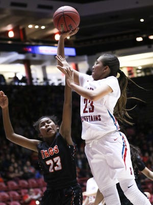 Shiprock's Tanisha Begay shoots over Taos' Aaliyah Quintana during their 4A state quarterfinal game on Tuesday at The Pit in Albuquerque.