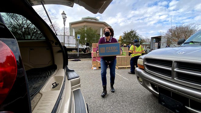 Holly Black loads a box into a car at the Patrick Senior Center for No Hunger Holidays on Friday. The event was hosted by Kings Mountain in partnership with Feed the Children.