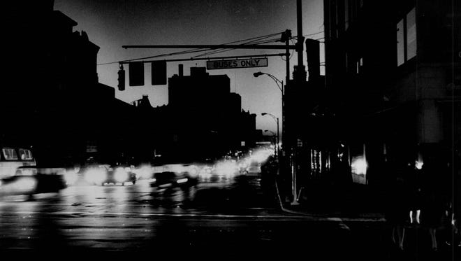 Car lights brighten the downtown area as homebound traffic piles up at Main Street during the November 1965 blackout. Police said then that hand-directed traffic moved well.
