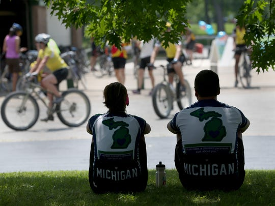 Donna Tolan and her husband, Kendall, of Middleville, Michigan, rest Monday as they stopped in Rochester during the 17th annual 400-mile Cycle the Erie Canal tour.