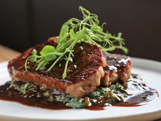 The Fat Lamb's veal meatloaf with traditional creamed spinach, mushroom and caramelized onion demiglace. $22.