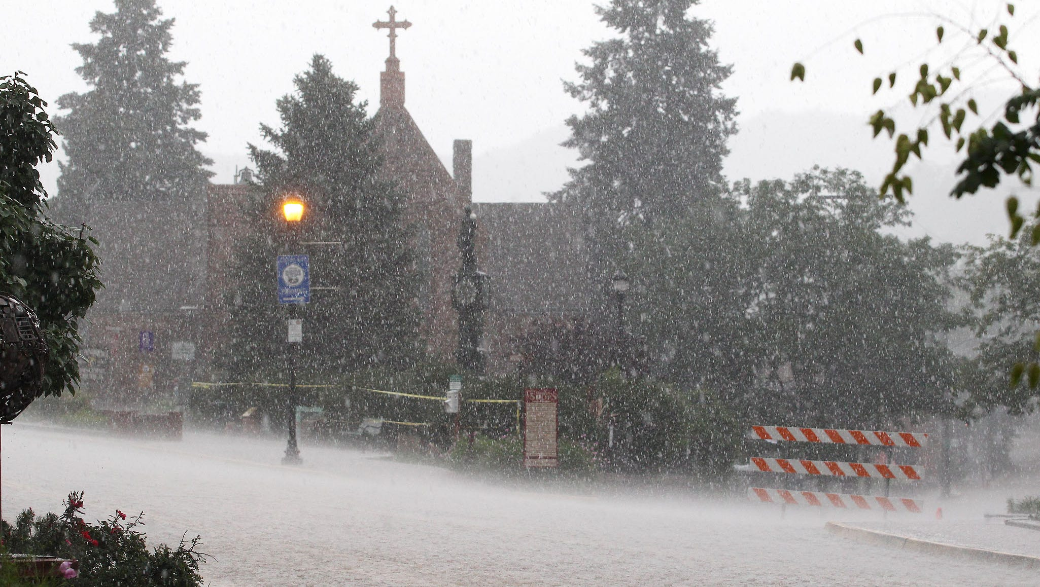 Roads are closed as rain and hail falls in Manitou Springs.