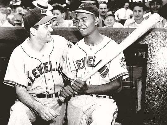 Manager Lou Boudreau and Larry Doby in the dugout at