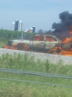 A car on fire on Interstate 41 near County B.