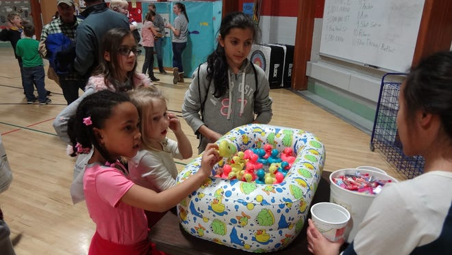 Students participate in the Washington Elementary School Carnival fundraiser.
