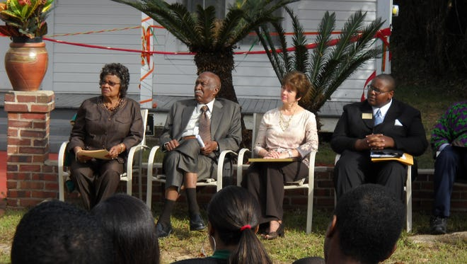 Lucille Alexander, James Ford, City Commissioner Nancy Miller and Taylor House curator Delaitre Hollinger at the grand opening of the Taylor House Museum, 442 W. Georgia St., on Oct. 29, 2011. In 1971, James Ford became the first black man elected to the Tallahassee City Commission and went on to serve 14 years.