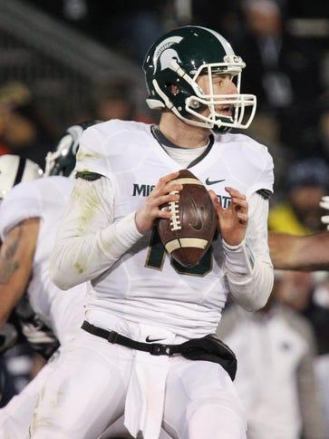 Michigan State Spartans quarterback Connor Cook (18)
