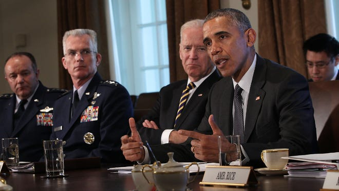 President Obama speaks as Vice President Biden  listens during a meeting with combatant commanders and Joint Chiefs of Staff in the Cabinet Room of the White House Tuesday.