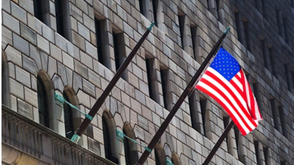A flag outside the Federal Reserve Bank of New York.