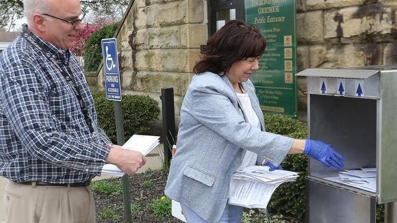 Ballots were collected from the drop box outside the Tuscarawas County Courthouse in April.