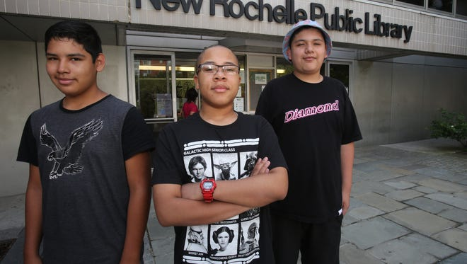 From left, George Ortiz, 14, Jose Tapia, 15, and Jordan Fudge, 14,  outside of the New Rochelle Public library on Friday are planning on submitting a film to the library's film festival.