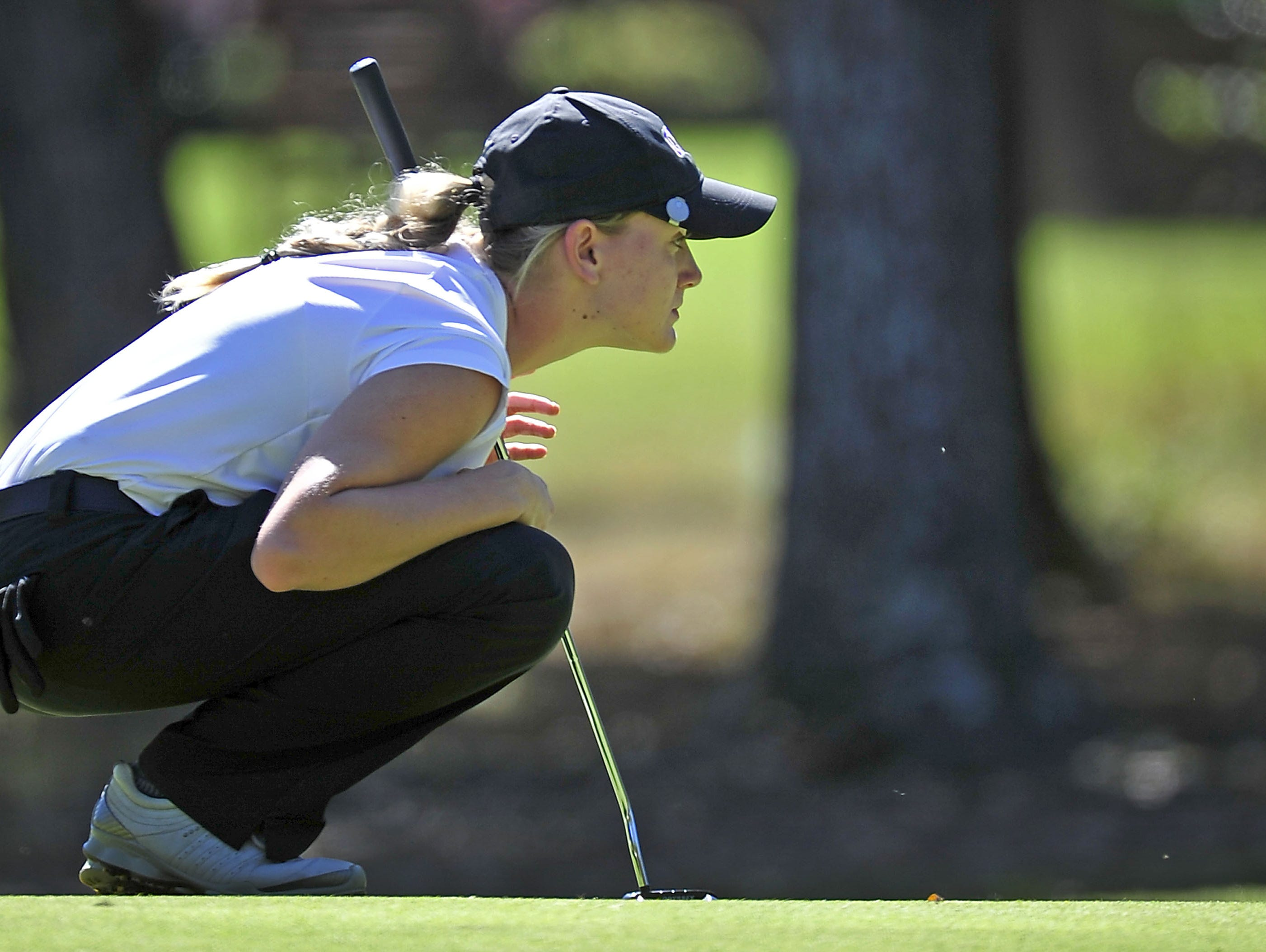 CPA's Siarra Stout won back-to-back Class A/AA state golf titles.