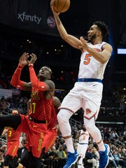 New York Knicks guard Courtney Lee, right,  shoots a layup against the defense of Atlanta Hawks guard Dennis Schroder, left, during the second half of a NBA basketball game, Friday, Nov.24, 2017, in Atlanta. The Hawks won 116-104. (AP Photo/John Amis)