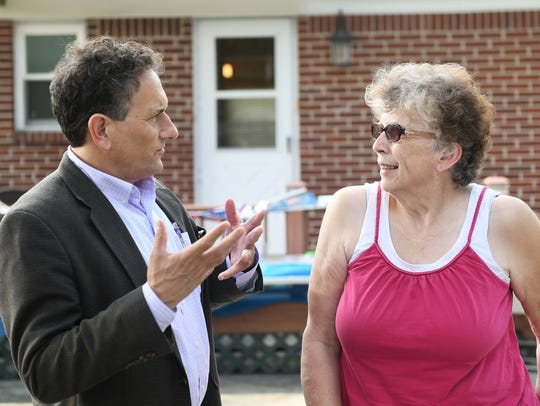 Candidate Andy Levin talks with voters including Betty