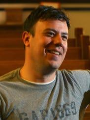 Campus pastor Chris Tillman poses for a portrait at