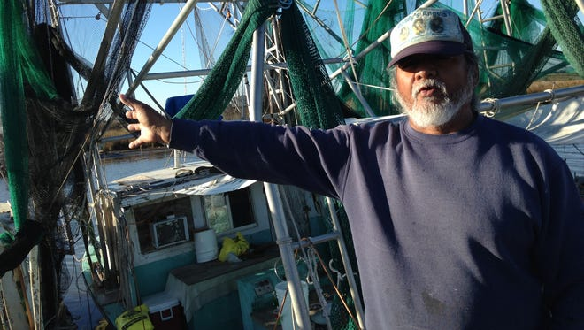 Flip Tayamen, 60, a shrimper from Plaquemines Parish, says nearby wetlands have vanished over the years. The National Oceanic and Atmospheric Administration recently removed the names of 40 places around Plaquemines from official maps because of land loss.