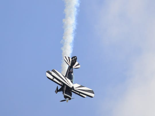 Dave Leedom performs an aerobatic maneuver for spectators