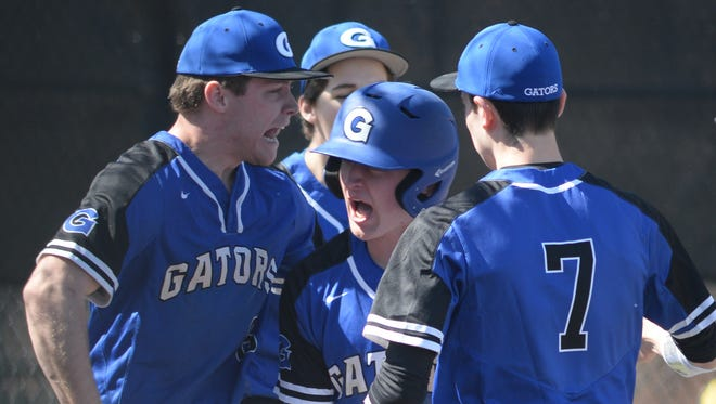 Gateway's Logan Cruet celebrates with his teammates after scoring a run against Gloucester earlier this season. Both teams made the Diamond Classic this year.