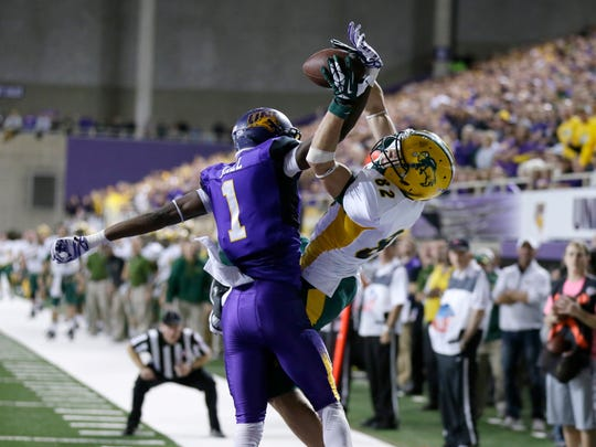 Northern Iowa defensive back Deiondre' Hall, left, breaks up a pass intended for North Dakota State wide receiver Zach Vraa during the first half of an NCAA college football game, Saturday, Nov. 8, 2014, in Cedar Falls, Iowa. (AP Photo/Charlie Neibergall)
