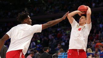 Wisconsin Badgers guard Bronson Koenig (24) warms up with forward Nigel Hayes (10) before the game against the Florida Gators in the semifinals of the East Regional of the 2017 NCAA Tournament at Madison Square Garden.