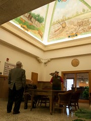 Visitors got a close-up look of the restored murals in the rotunda during tours of the Ottawa County Courthouse in Port Clinton on Sunday.