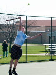 Clyde's Alex Kauble serves during his doubles match with partner Janne Fromberg at Port Clinton High School on Thursday afternoon.