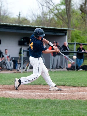 Donovan Reyes, hitting a home run as a sophomore, is among Woodmore's returning players.