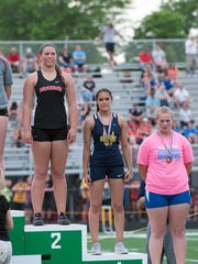 Woodmore's Analicia Torres was fourth in the shot put
