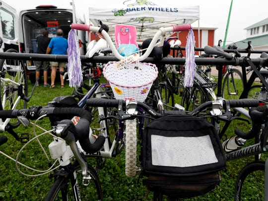 A child's bicycle hangs on a bar next to adult road bikes Thursday morning, June 21, 2018, at the Fairfield County Fairgrounds in Lancaster.
