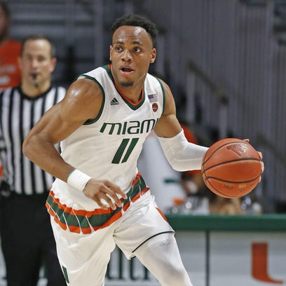 Miami's Bruce Brown drives the ball down court against