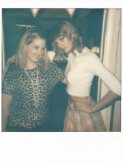 Stefani Spencer, 22, of Tulare, poses with Taylor Swift in a door frame of Swift's Beverly Hills home.