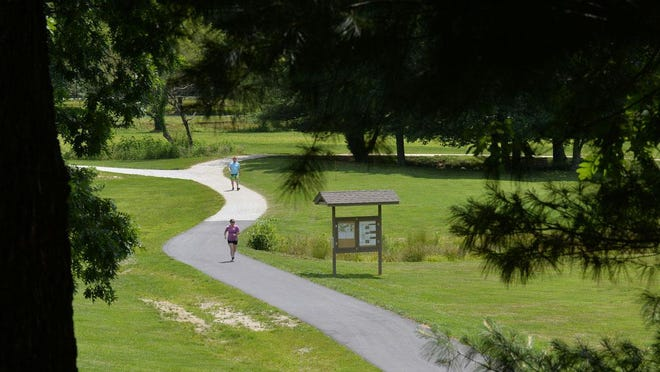 In this June 7, 2017 photo, people take advantage of day's good weather at The Park at Flat Rock.