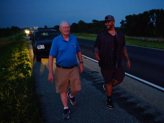State Trooper Charlie Black meets John Govia, whom he saved 30 years ago when he was on the Iowa State Patrol, on Wednesday, July 19, 2017 in Des Moines.