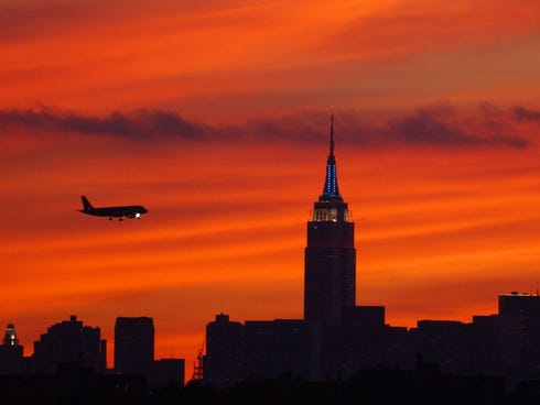 In this Aug. 2, 2002 file photo, a jet is seen on an approach to LaGuardia Airport.