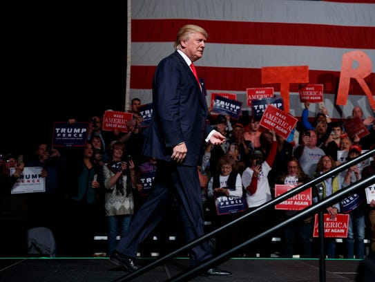 Donald Trump arrives to speak at a rally in Bangor,