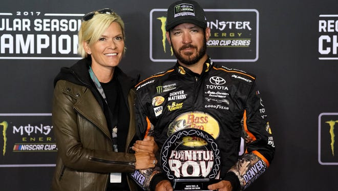 Martin Truex Jr. and his girlfriend Sherry Pollex celebrate his regular-season title, which gives him the No. 1 seed entering the NASCAR Cup Series playoffs.
