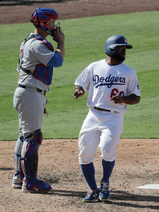Los Angeles Dodgers' Andrew Toles right, scores past Chicago Cubs catcher David Ross on a ball hit by Adrian Gonzalez during the eighth inning of a baseball game in Los Angeles, Sunday, Aug. 28, 2016. The Dodgers won 1-0. (AP Photo/Chris Carlson)