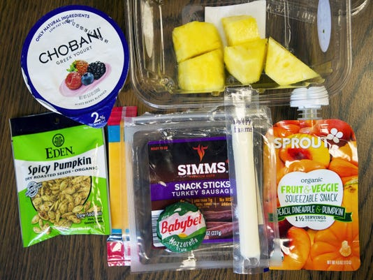 """Group of foods recommended for healthy """"junk food"""". (Paul Kuehnel - York Daily Record/ Sunday News)"""