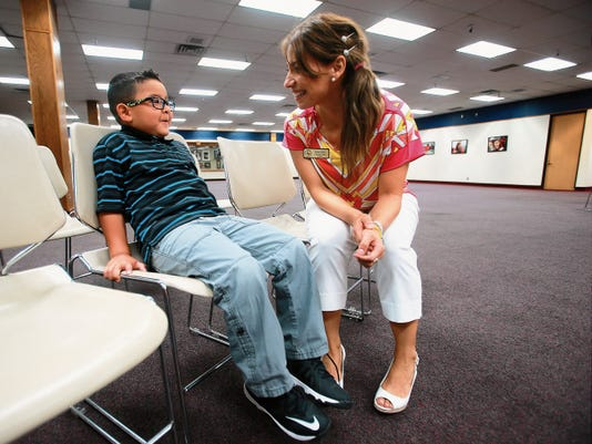 Ysleta Pre-K Center Principal Sandra Perez talked with pre-K graduate Alexsandro Escajeda following a news conference Tuesday at the Ysleta Independent School District Central Office.