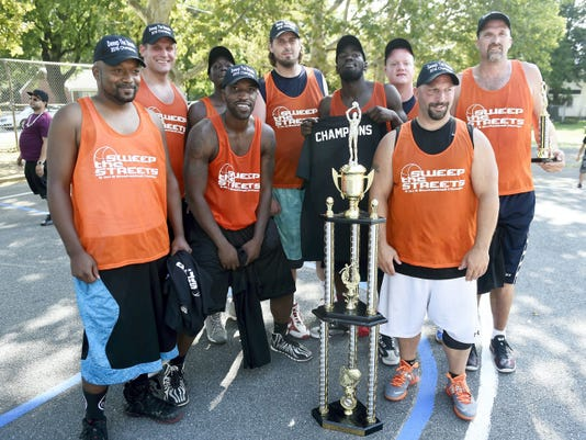 The annual Sweep the Streets basketball tournament held in Lebanon at South East playground on Sunday came down to DePac, of Baltimore, Maryland, vs. Eisenhauer Nissan, of Reading. Eisenhauer Nissan edged out DePac to win the Championship Game. Eisenhauer poses for a team shot with the championship trophy.